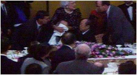 7 Mrs. Bush covered President Bush's mouth. Source NHK TV